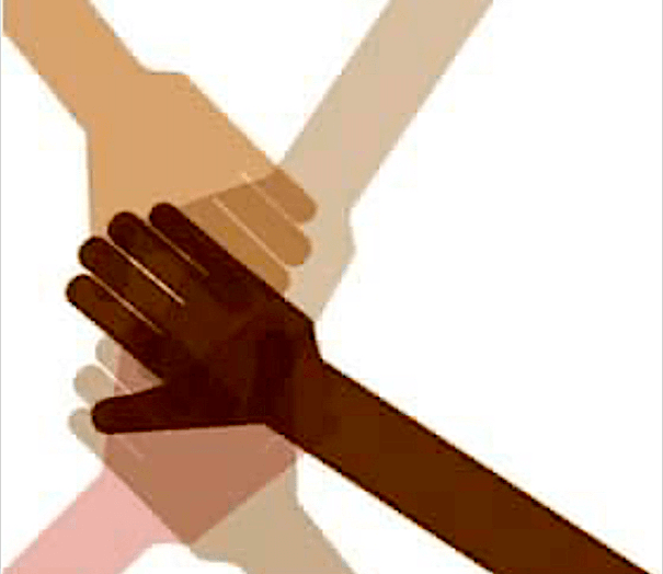 Multi-racial hands grasping each other